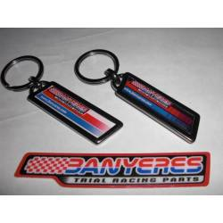 Jbanyeres Parts metal two-sided keychain with drop adhesive one side in black and the other white.